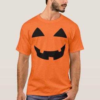 ハロウィーンのカボチャのちょうちんは直面します Tシャツ