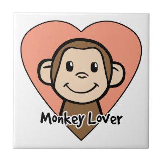 ハートのかわいい漫画の切り貼り芸術のスマイル猿愛 タイル