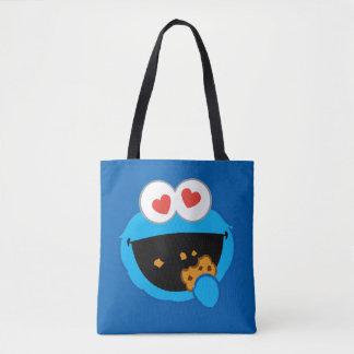 ハート形の目が付いているクッキーの微笑の顔 トートバッグ