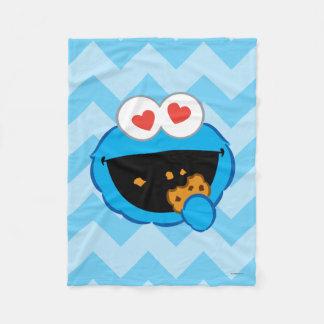 ハート形の目が付いているクッキーの微笑の顔 フリースブランケット
