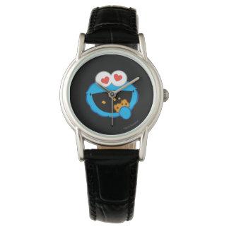 ハート形の目が付いているクッキーの微笑の顔 腕時計