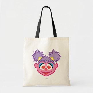 ハート形の目が付いているAbbyの微笑の顔 トートバッグ