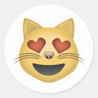 ハート形の目Emojiが付いている微笑猫の顔 ラウンドシール