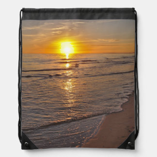 バックパック: ビーチによる日没 ナップサック