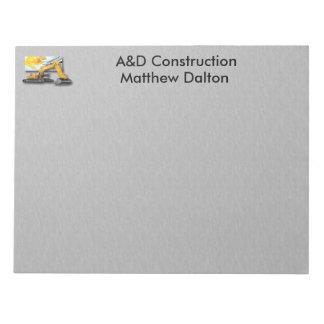バックホウのメモ帳との建築の灰色 ノートパッド