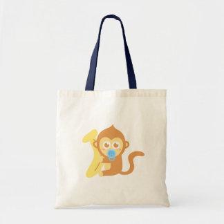 バナナを持つかわいい漫画のベビー猿 トートバッグ