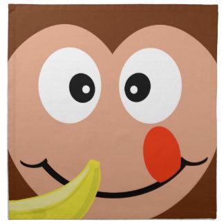 バナナを持つかわいい猿は布のナプキンをからかいます ナプキンクロス