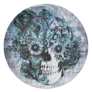 バラが付いている青くグランジなオームのスカル プレート