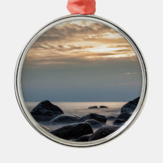 バルト海の日没そして石は惰走します メタルオーナメント