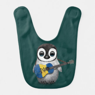 バルバドスの旗のギターのティール(緑がかった色)を遊んでいるベビーのペンギン ベビービブ