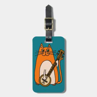 バンジョーの漫画を遊んでいるかわいいオレンジ猫 ラゲッジタグ