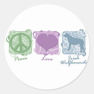 パステル調の平和、愛およびアイリッシュ・ウルフハウンド ラウンドシール