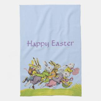 パステル調の衣服のイースターウサギを走っているグループ キッチンタオル