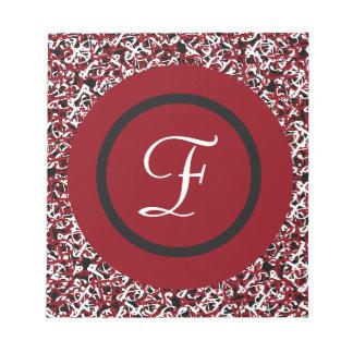 パターンのシックで赤く黒く及び白いモノグラムのイニシャル ノートパッド