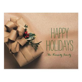 ヒイラギと飾られるクリスマスプレゼント ポストカード