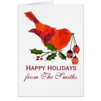 ヒイラギを持つ赤いクリスマスの鳥 カード