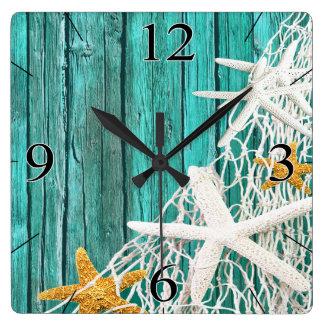 ヒトデの網のビーチの木製の沿岸生活 の水 スクエア壁時計