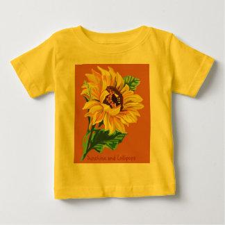 ヒマワリ、日光および棒つきキャンデーのTシャツ ベビーTシャツ