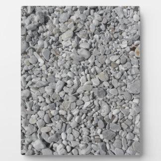 ビーチの海岸からの小石の質 フォトプラーク