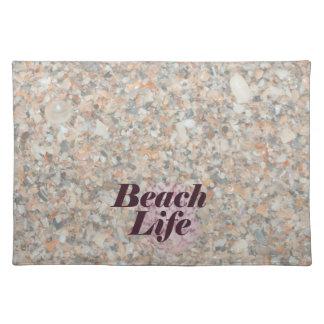 ビーチの生命は押しつぶされた貝の帆立貝を洗浄しました ランチョンマット