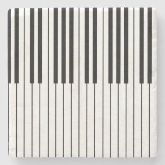 ピアノはアイボリーの白くおよび黒い調整します ストーンコースター