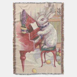ピアノHyacinthを遊ぶイースターのウサギ スローブランケット