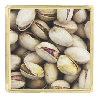 ピスタチオナッツの背景 ゴールド ラペルピン
