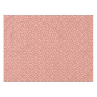 ピンクおよびばら色の円によってはパターン(の模様が)あるなテーブルクロスが開花します テーブルクロス