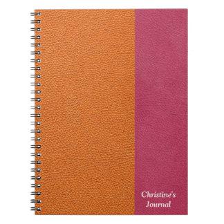 ピンクおよびオレンジレザールック ノートブック