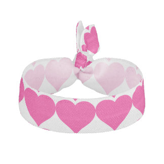 ピンクおよび白いハートパターン ヘアタイ