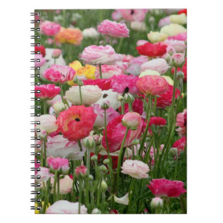 ピンクおよび白い庭の花が付いているノート ノートブック