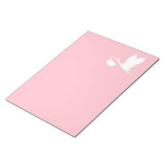 ピンクおよび白く飛んでいるなこうのとり ノートパッド
