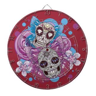 ピンクおよび紫色の円の砂糖のスカルの蝶 ダーツボード