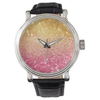 ピンクおよび金ゴールドのグリッターの一見 腕時計