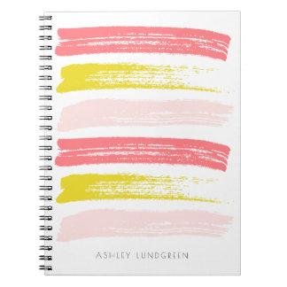 ピンクおよび黄色い水彩画のブラシはカスタムをなでます ノートブック