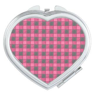 ピンクおよび黒い格子縞の点検の鏡のハート