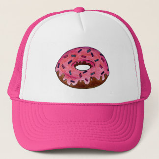 ピンクによって曇らされるドーナツドーナツはドーナツの帽子を振りかけます キャップ