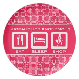 ピンクのおもしろいなShopaholicは睡眠の店賞を食べます プレート