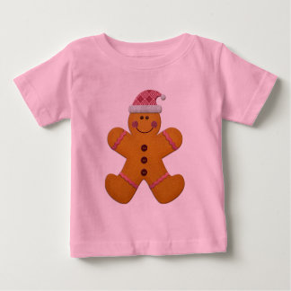 ピンクのかわいく陽気なジンジャーブレッドマン ベビーTシャツ