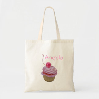 ピンクのカップケーキおよびさくらんぼが付いている子供のギフトの名前のバッグ トートバッグ