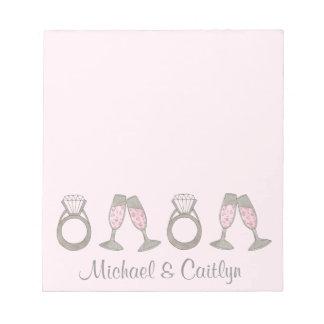 ピンクのダイヤモンド指輪のシャンペンの結婚式の花嫁のメモ帳 ノートパッド