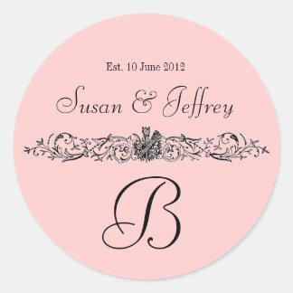 ピンクのモノグラムのロゴは日付の結婚式のラベルを示します ラウンドシール