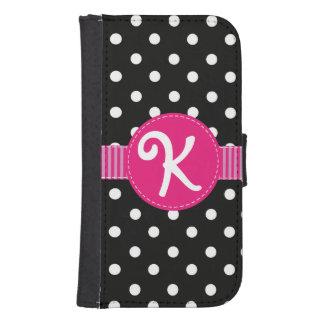 ピンクのリボンが付いている黒く及び白い水玉模様 ウォレットケース