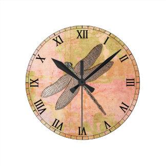 ピンクの印象の金属のトンボ ラウンド壁時計