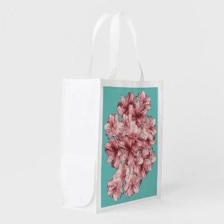 ピンクの図解入りの、写真付きのな花の可変性の背景 エコバッグ
