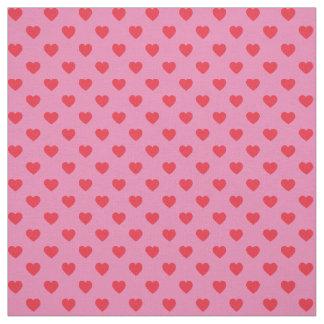 ピンクの小さいハートパターンの赤 ファブリック