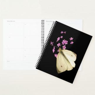 ピンクの庭の蝶によっては花柄が開花します プランナー手帳