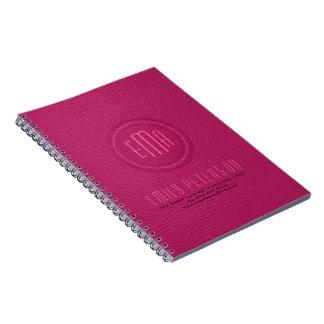 ピンクの模造のなレザールックのモノグラム ノートブック