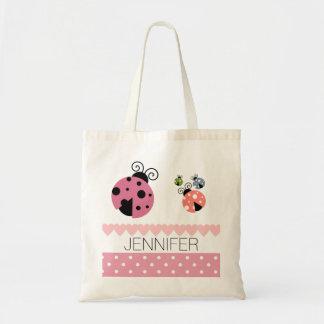 ピンクの水玉模様のてんとう虫のハートのブックバッグ トートバッグ