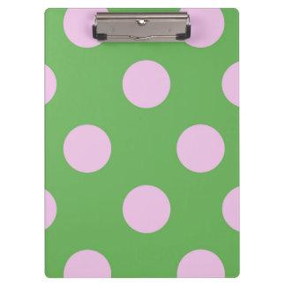 ピンクの点が付いているカスタマイズ可能な緑の背景 クリップボード